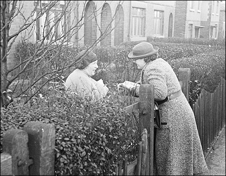 women-talking-at-fence